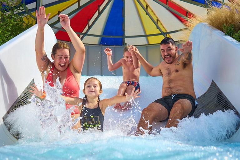 family on water slide at butlins