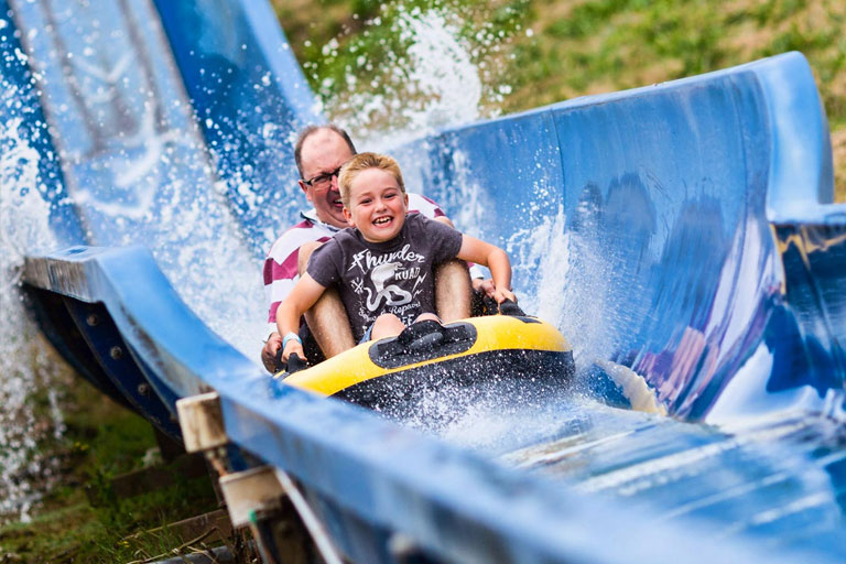 father and son on log flume