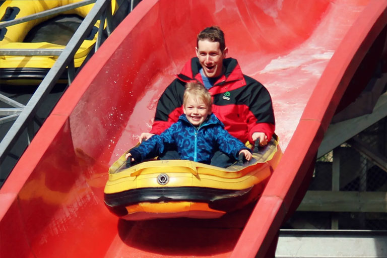 father and son on flume landmark forest