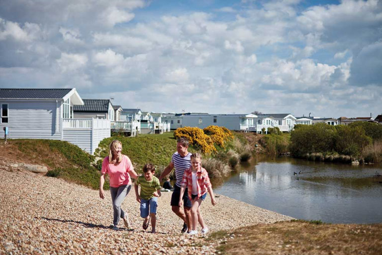 family on beach resort at Parkdean Resorts