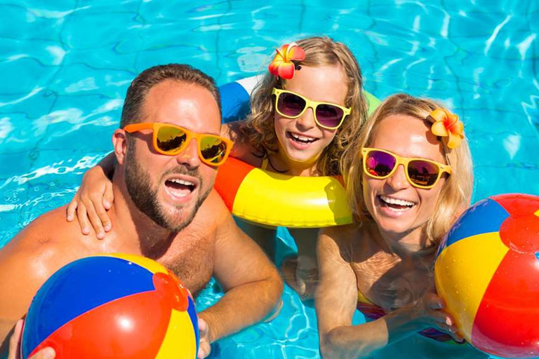 family in swimming pool at Parkdean Resorts