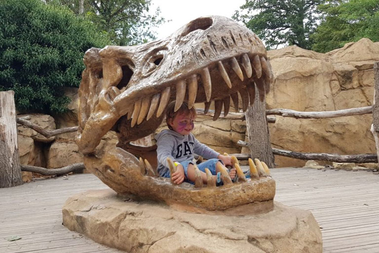 kid in a t-rex mouth