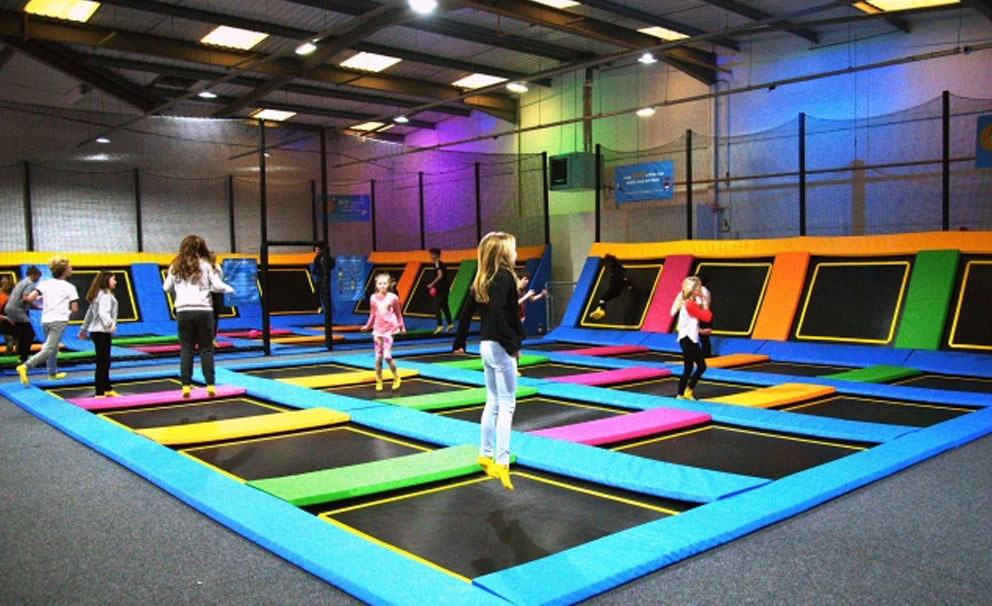 kids playing at trampoline park